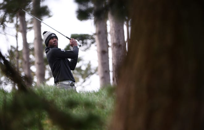 Kamaiu Johnson plays his shot from the 11th tee during the first round of the AT&T Pebble Beach Pro-Am golf tournament at Spyglass Hill Golf Course on Feb. 11. [Orlando Ramirez-USA TODAY Sports]