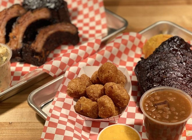 That's a Rack BBQ at Grandview Public Market specializes in smoky ribs. GRANDVIEW