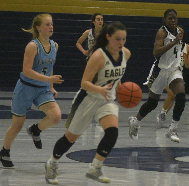 Isabella LoBue (23) and J'Nyria Kelley (4) were among standouts for St. John in a 58-22 win over Catholic-Pointe Coupee in first-round Division IV playoff action Monday. St. John travels Thursday, Feb. 25 to Ruston for action against Cedar Creek for second-round fare.