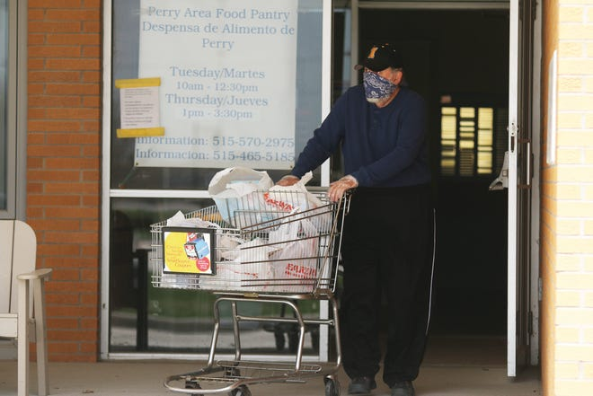 Items are delivered to cars in April of 2020 at the Perry Area Food Pantry. The pantry's building fund was selected as the 100+ People for Perry first quarter recipient on Feb. 22.