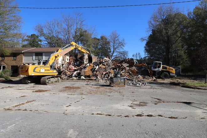 In this January 2021 photo from the Petersburg Redevelopment and Housing Authority, heavy equipment works on demolishing one of the housing units in the Pin Oaks community.