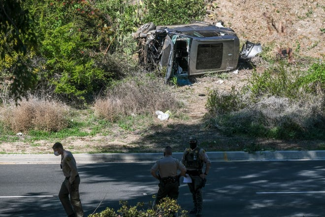 A vehicle driven by Tiger Woods rests on its side after a rollover crash on a road in the Rancho Palos Verdes section of Los Angeles on Tuesday.