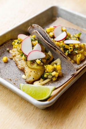 A fish dish with mango salsa from chef Mariana Gonzalez-Trasvina's pop-up La Vecina in Newport.