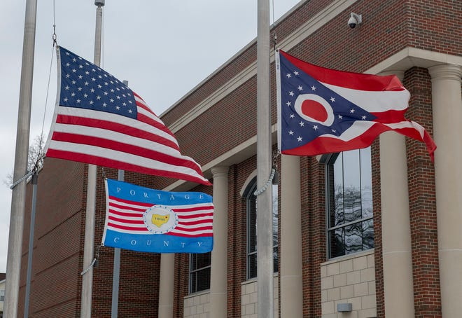 Flags, including those at Portage County Municipal Court in Kent, were lowered to half staff to honor the more than 500,000 Americans who have died from COVID-19. They will remain lowered until sunset on Friday.