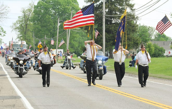The Streetsboro American Legion Post 685 color guard marches in the Memorial Day parade on S.R. 303 in Streetsboro on Sunday afternoon. Photo by: Amanda Woolf