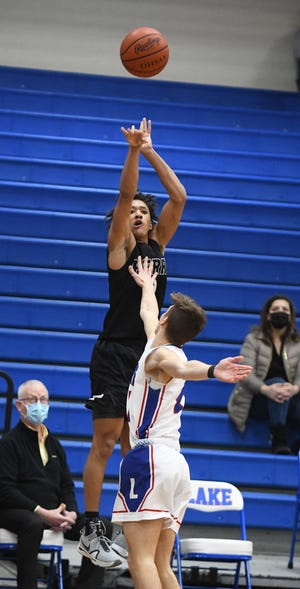 Perry's Quentin Toles shoots against Lake on Monday during a game at Lake. Feb. 22, 2021.