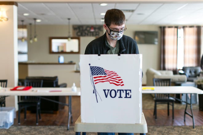 Kyle Reed of Rockford marks his ballot at Maywood Evangelical Free Church on Tuesday, February 23, 2021, in Rockford.