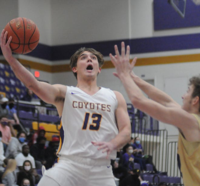 Kansas Wesleyan's Brayden White (13) puts up a one-handed shot during Monday's game against Avila at Mabee Arena.