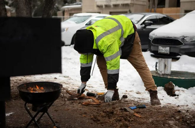 Jacob Duran cooked his meals outside last week after his apartment lost power in Southeast Austin.