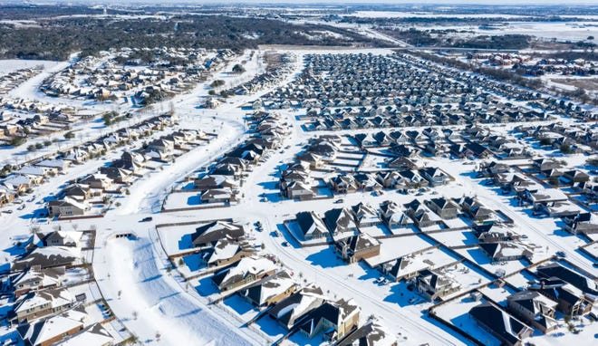 The Blanco Vista neighborhood of San Marcos was blanketed with several inches of snow Feb. 15 after a massive winter weather system engulfed Texas, causing widespread power outages across the state.