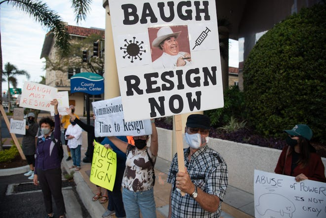 Manatee County residents protest on Tuesday with calls for the resignation of Manatee County Commissioner Vanessa Baugh.