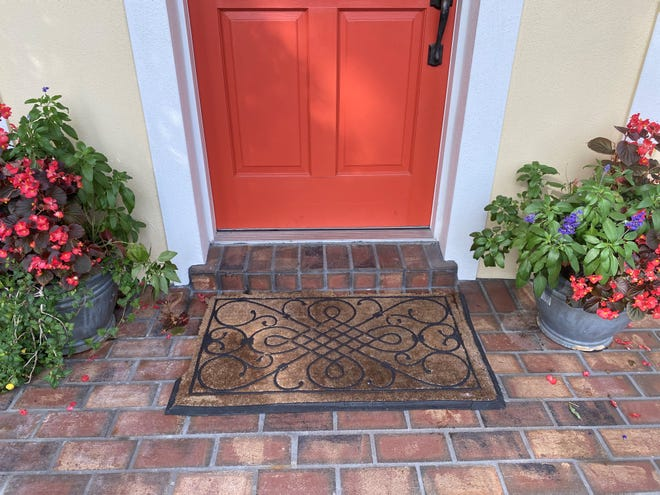 SHOW YOU CARE: Your front door is your handshake to the world. If your tattered doormat isn't welcoming, like the one pictured above, spring for a new one. Ideally, you want one a little wider than your threshold, as pictured. (Photos courtesy of Marni Jameson)