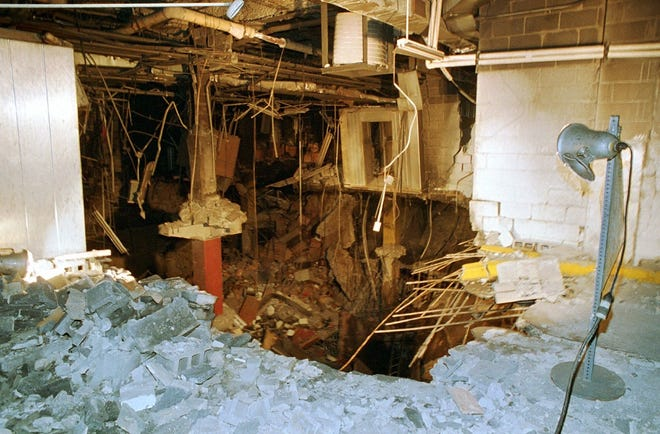 The crater in an underground parking garage from the World Trade Center explosion is shown in this Feb. 26, 1993 photo. The blast left at least five people dead and several hundred injured.