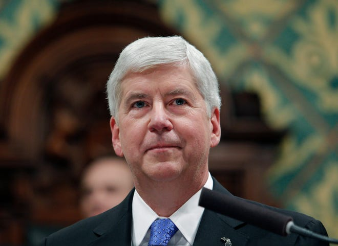 FILE - In this Jan. 23, 2018, file photo, then, Michigan Gov. Rick Snyder delivers his State of the State address at the state Capitol in Lansing, Mich. A pretrial hearing is scheduled Tuesday, Feb. 23, 2021, for Snyder, who is accused of two misdemeanor counts of willful neglect of duty in connection with the lead contamination of drinking water in Flint, Mich., and a fatal outbreak of Legionnaires' disease. (AP Photo/Al Goldis, File)