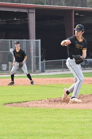 Richmond Hill junior pitcher Luke Boone delivers a pitch against Benedictine earlier this season.