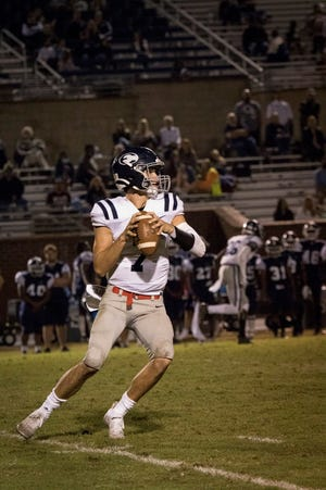 Effingham County quarterback Zach Garcia looks to throw downfield during a recent game. Garcia held his signing party on Friday to celebrate his football scholarship from St. Augustine's University, a Division II school in Raleigh, N.C.