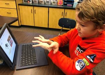 Adrian Marley, an Oklahoma School for the Deaf third grader from Blanchard, uses AvePM software apps to improve his language skills.