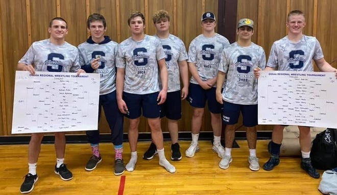 Seven members of the Shawnee High School wrestling squad pose after competing in regionals on Monday.
