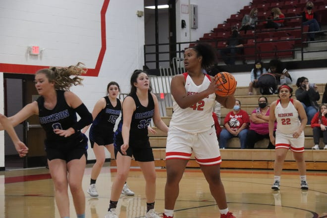 McLoud's Cheyenne Banks (42) looks to dish off the ball from the high post Monday during Class 4A district play in McLoud.