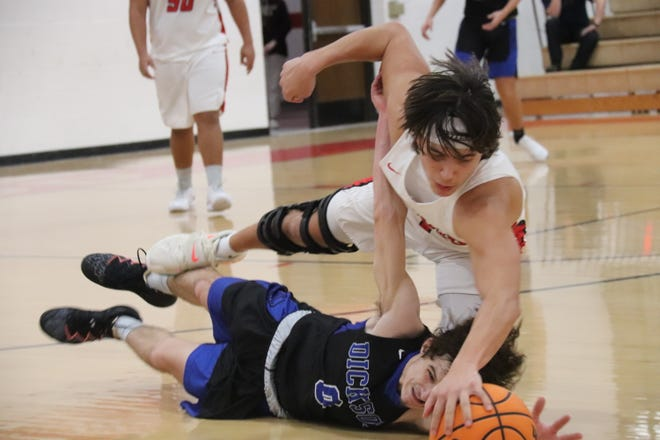McLoud's Collin Gibson (1) and Dickson's Josh Palesano (0) hit the floor for a loose ball Monday night during Class 4A district play.
