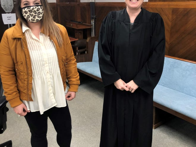 Volunteer Kelsey Case, left, recently completed training at Youth and Family Resource Center, Inc. in Shawnee and is pictured with Associate District Judge Tracy McDaniel.