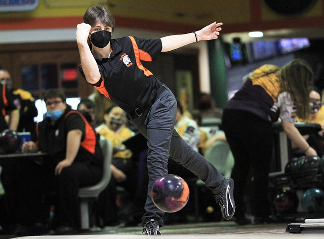 Drake Harker bowls for the Trojans on Monday afternoon at Bronson Strike Zone.