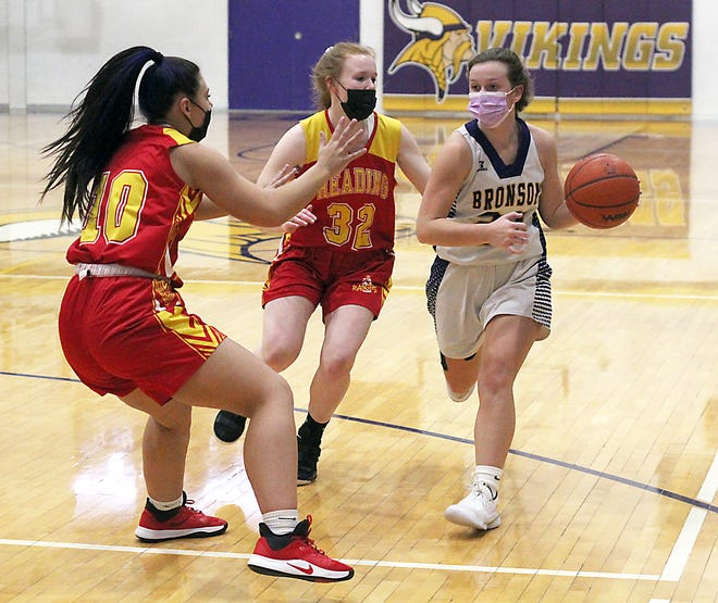 Meagan Lasky of Bronson pushes the ball up the floor against Reading on Monday.