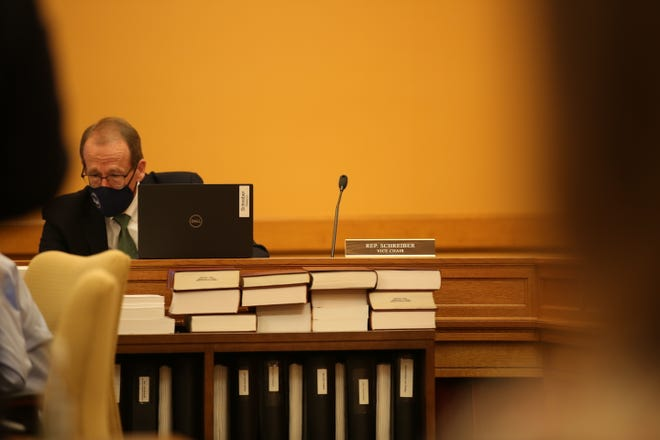 State Rep. Mark Schreiber, R-Emporia, looks at notes as he listens during a hearing Tuesday on his bill that would create a statewide energy task force.
