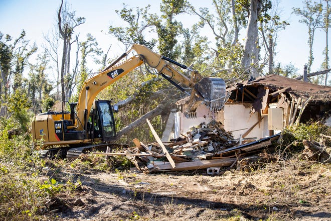 Workers use heavy equipment to take down a home on Rita St. in Lynn Haven that was damaged by Hurricane Michael. The Bay County Private Property Debris Removal Program demolished property number 251 Tuesday, February 23, 20201. The program started a year ago. Since the program began they have demolished 336 structures and removed 65,000 cubic yards of debris. In addition they have removed 4,500 hazardous trees and collected 104,000 cubic yards of vegetation debris.