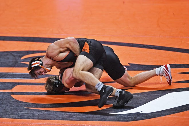 Hunter Willits, top, puts an opponent to the mat in a match for Oregon State University