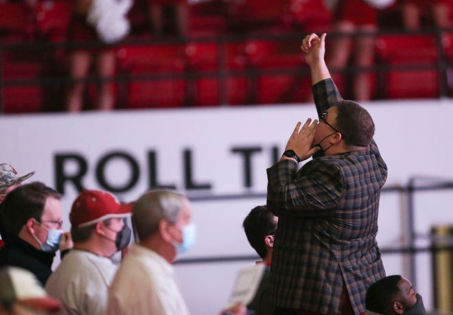 Cameron Luke Ratliff leads the cheers in the student seating area as the Crimson Tide hosted Vandy Saturday, Feb. 20, 2021, in Coleman Coliseum. [Staff Photo/Gary Cosby Jr.]