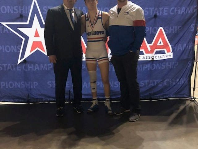 ACA's River Scruggs, center, with, from left, coach Steve Davis and assistant coach John Shuttlesworth  after Scruggs won the 2021 AHSAA Class 1A/3A state wrestling championship on Feb. 13 in the 138-pound weight class