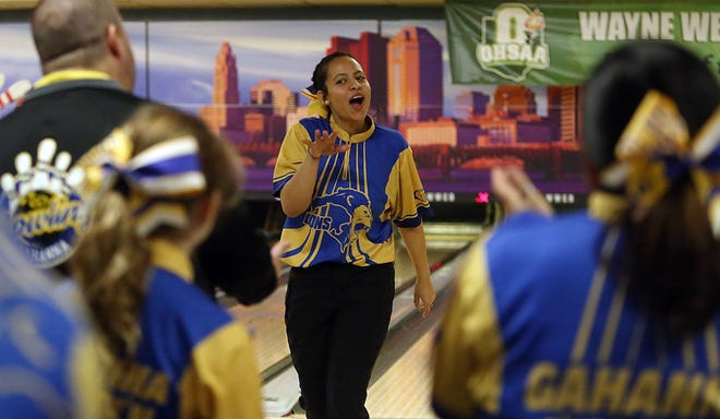 Gahanna Lincoln's Addison Watson celebrates after rolling a strike during last year's Division I state tournament, where the Lions won the championship. On Feb. 22, Watson helped Gahanna win the district title and earn a return trip to state.