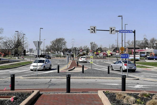 Vehicles pass through the roundabout at Main Street and Scioto Darby Road in April 2020. Modifications at the roundabout will be made permanent, and they will include raised crosswalks to slow vehicle speeds and increase pedestrian safety.