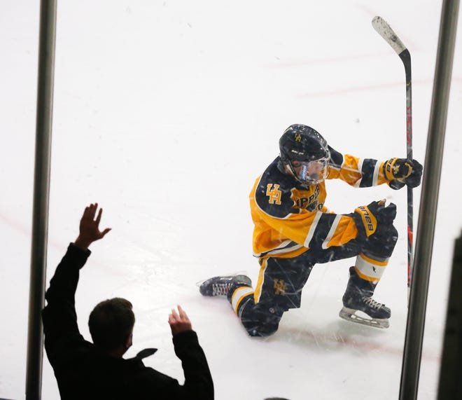 Max Robins celebrates a goal in Upper Arlington's Blue Jackets Cup championship game victory over St. Charles on Feb. 14. Robins led the Golden Bears with 33 goals through 31 games.