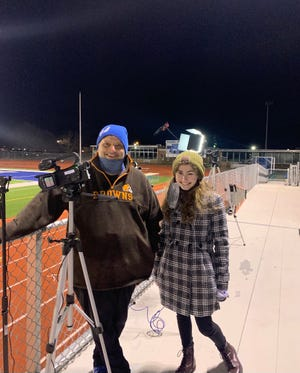 """Lincoln Live instructor Mark Lowrie and Gahanna Lincoln High School junior Gabriella Fabrizio collaborate to film """"Holding it Together"""" on Jan. 23. Fabrizio aspires to be a filmmaker and edited most of the production."""