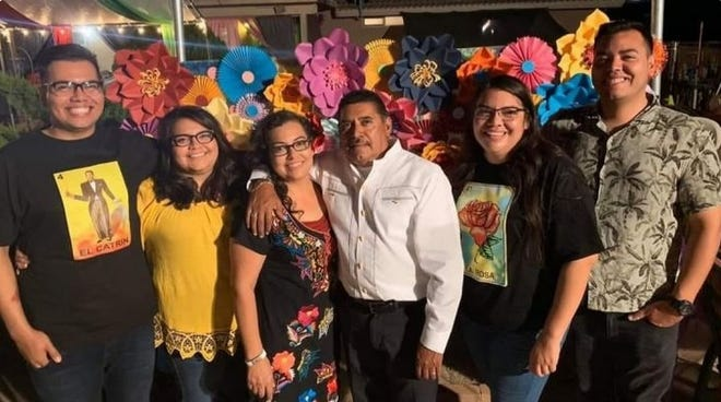Jose and Maria Davalos, center, of Hesperia, and their children in an undated photo. Jose Davalos was a musician and concrete worker who died in December after contracting COVID-19.