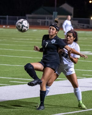 Waxahachie junior midfielder Kaydence Ramirez (7) holds possession during a home match earlier this season.