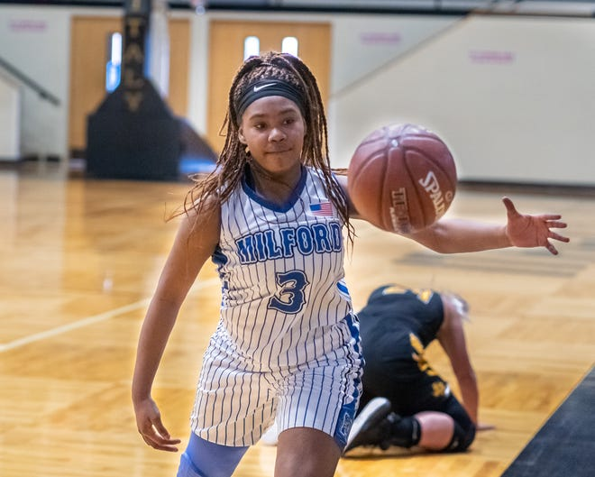 Milford freshman Lynia Brooks chases down a loose ball during Saturday's Class 1A Region IV bi-district playoff game against Jonesboro at Italy. The Lady Bulldogs advanced with a 49-40 victory.