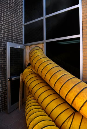 Dryer hoses lead into a side door of the Abilene Taylor County Public Health District Tuesday Feb. 23, 2021.
