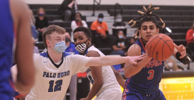 Cooper point guard Noah Garcia, right, passes the ball to a teammate while Amarillo Palo Duro's Cutter Camp (12) defends in the second half.