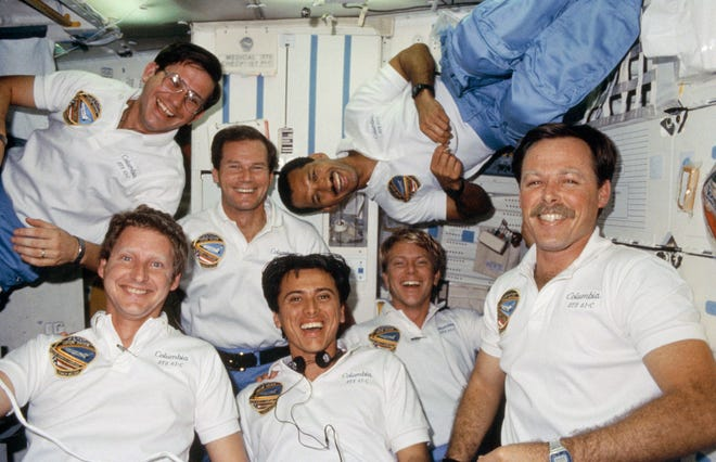 Then-Congressman Bill Nelson flew aboard the space shuttle Columbia's STS-61C mission in January 1986. Astronaut Robert Gibson, lower right corner, commander, is surrounded by, counter-clockwise from upper right: astronaut Charles Bolden, pilot; Nelson, payload specialist; Robert Cenker, RCA payload specialist; and astronauts Steven Hawley, Franklin Chang-Diaz and George Nelson, all mission specialists.