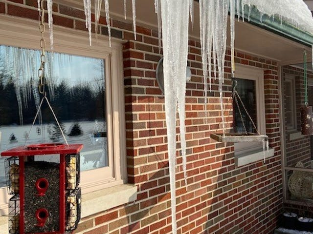 This 58 inch icicle in front of the Minors' kitchen window brought sparks to alter boredom in a long, cold week.