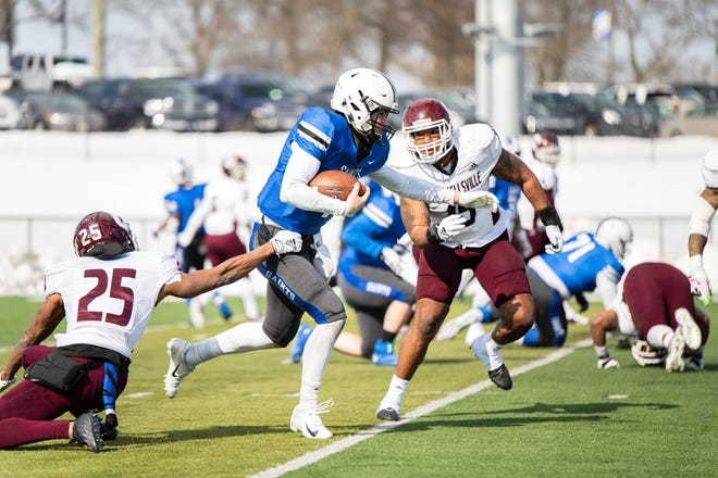 Quarterback Jay Volpenhein gets loose in Thomas More's win over Campbellsville. Volpenhein was ECC Offensive Player of the Year his junior and senior seasons at Anderson.