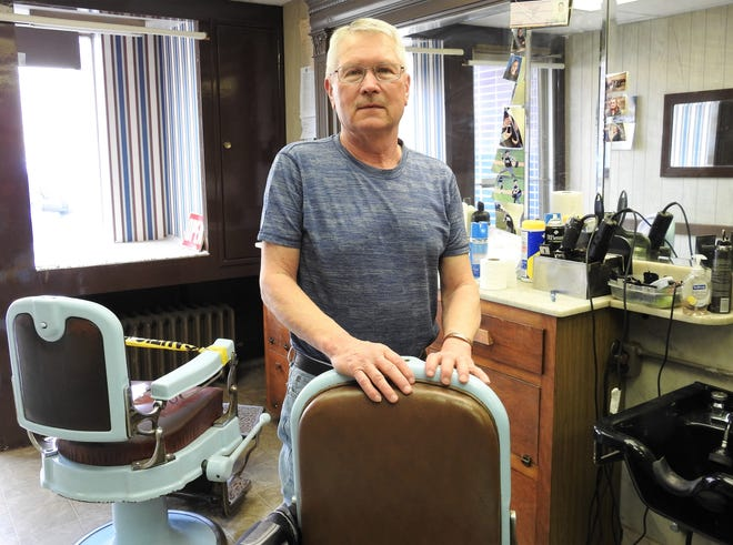 Bruce Shrimplin of Shrimplin's Barber Shop opened his business on Main Street in 1969. He recently returned to work part time after a health issue. He never plans to retire.