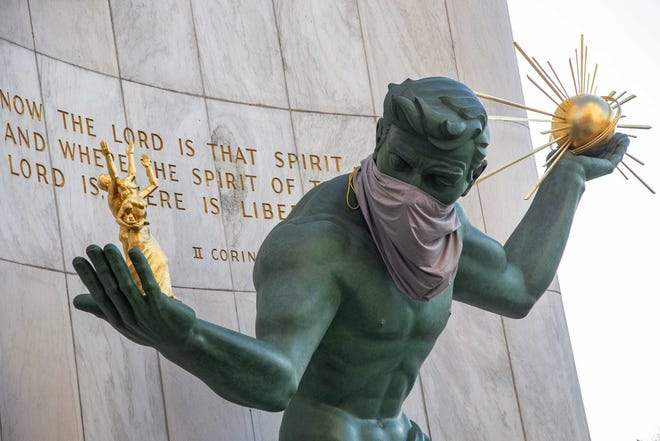The Spirit of Detroit statue dons a makeshift mask.