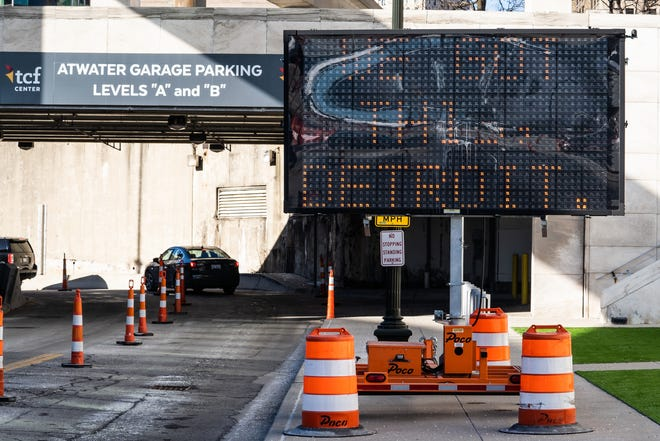 Vehicles pull in as people wait to get their first shot of the Moderna COVID-19 vaccine in an underground parking garage at TCF Center in downtown Detroit on Wednesday, February 3, 2021 as part of a drive-up distribution for the city of Detroit.
