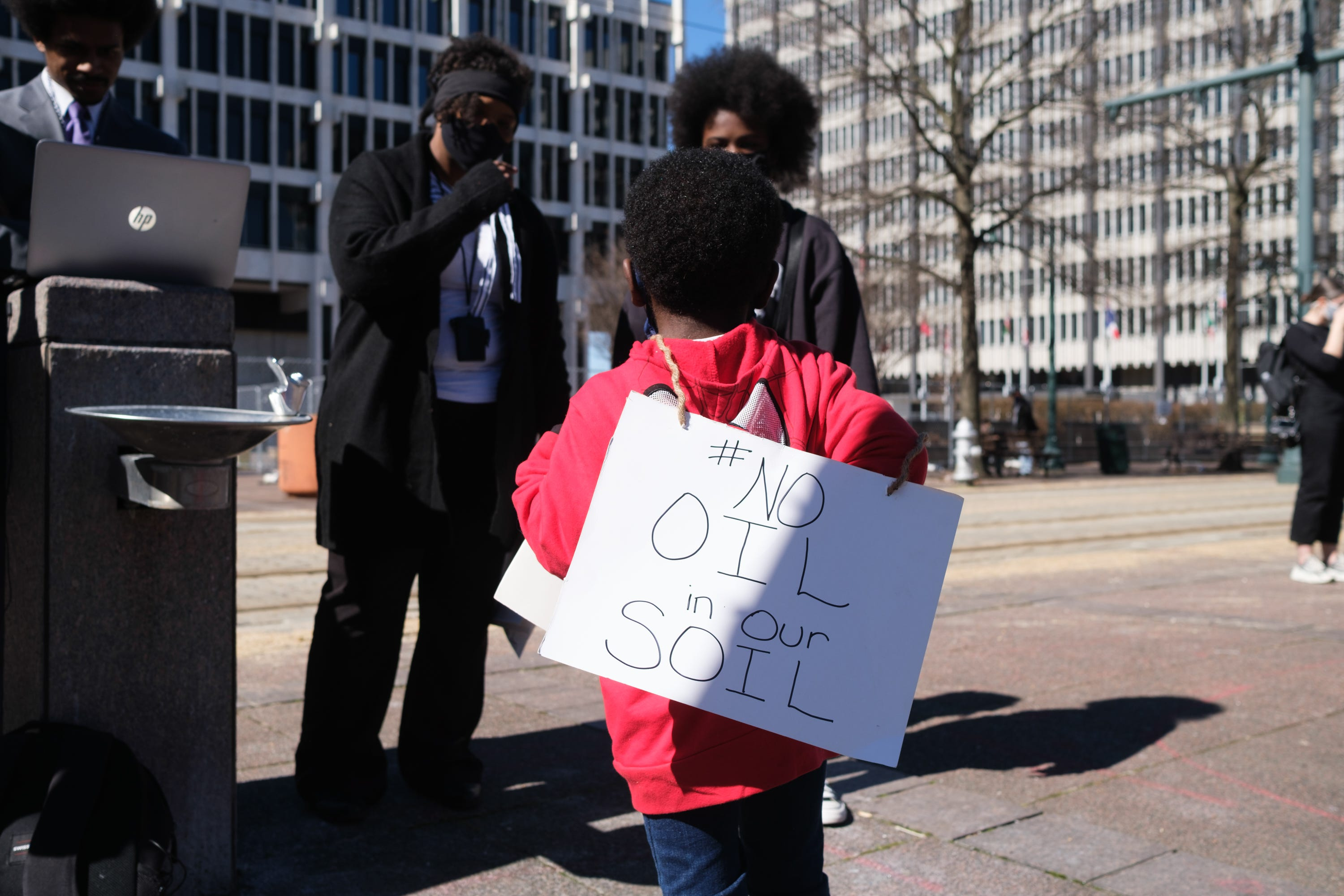 A young boy wears a sign outside of City Hall, protesting the construction of the Byhalia Connection Pipeline, Tuesday, Feb. 23, 2021, in Memphis, Tenn.