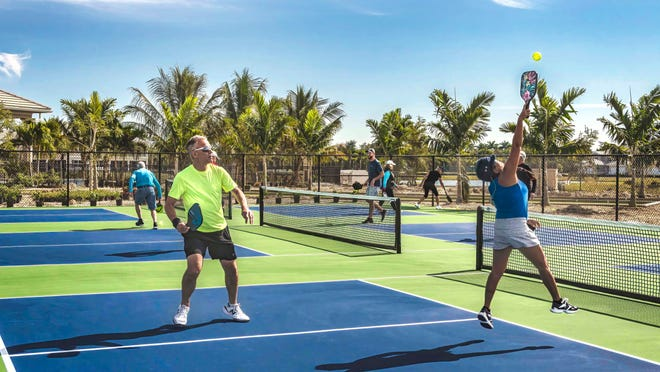 Residents are enjoying a game of pickleball on the regulation quad-courts at Antilles Flamingo Club.