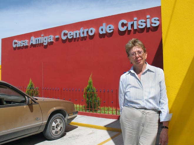 Esther Chavez Cano in front of the women's shelter she founded.